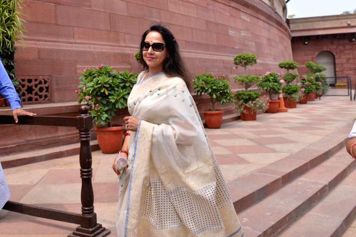 New Delhi: BJP MP Hema Malini arrives at Parliament, in New Delhi on July 8, 2019.