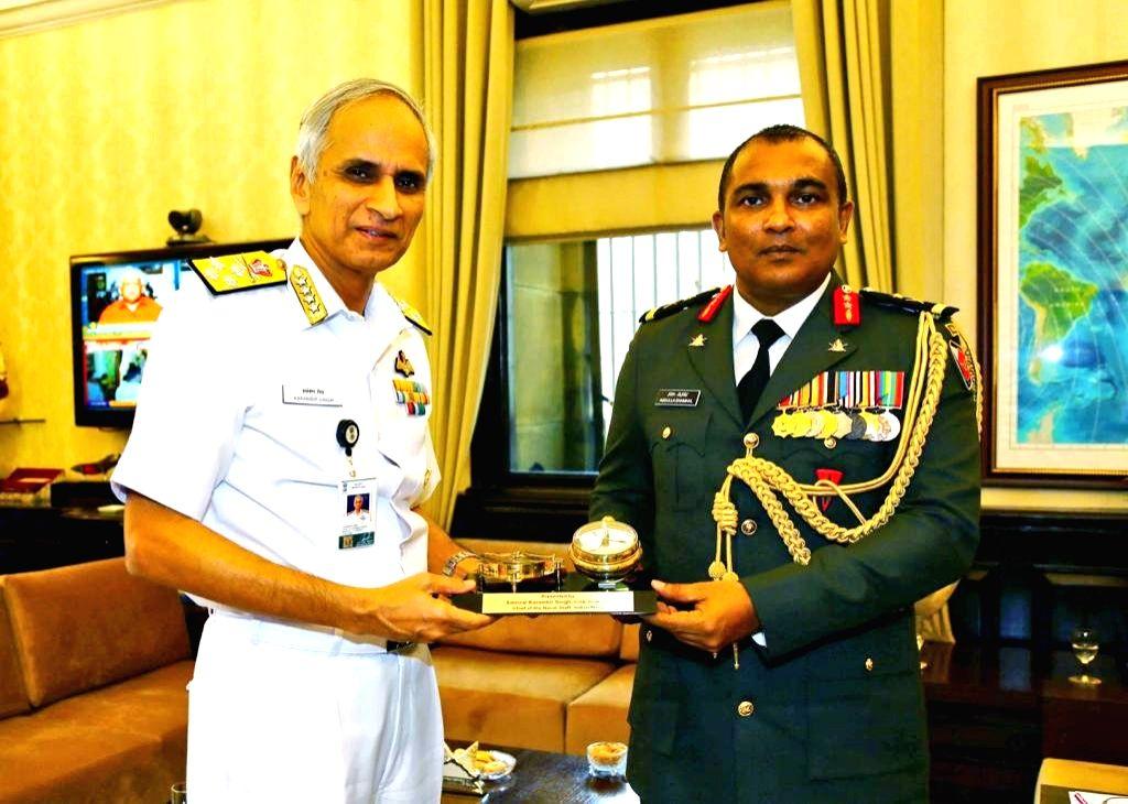 New Delhi: Chief of Defence Forces, Maldives National Defence Force, Major General Abdulla Shamaal meets Navy Chief Admiral Karambir Singh, in New Delhi on July 5, 2019. (Photo: IANS/DPRO)