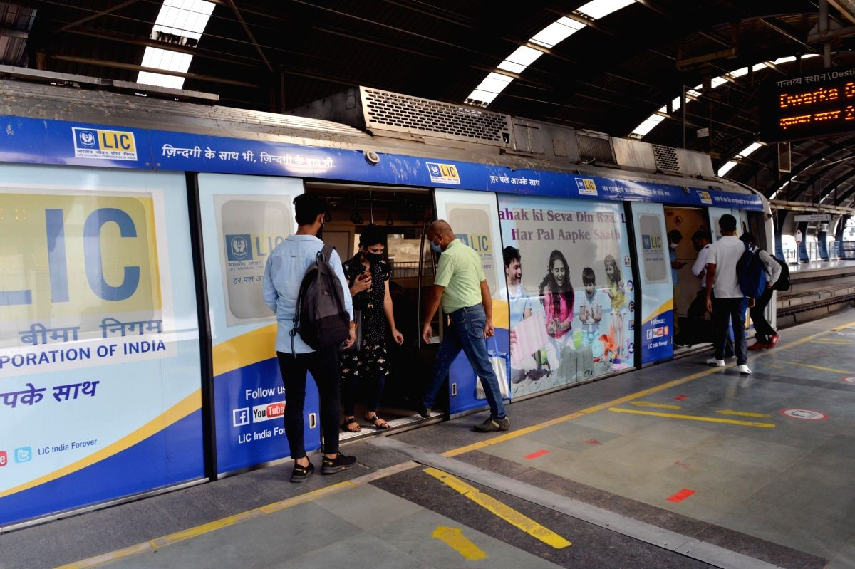 New Delhi: Commuters boarding a metro at a metro station after the Delhi Metro started operations on its two more additional lines -- Blue and Pink, providing relief to hundreds of commuters, in New Delhi on Sep 9, 2020. The resumption of service com