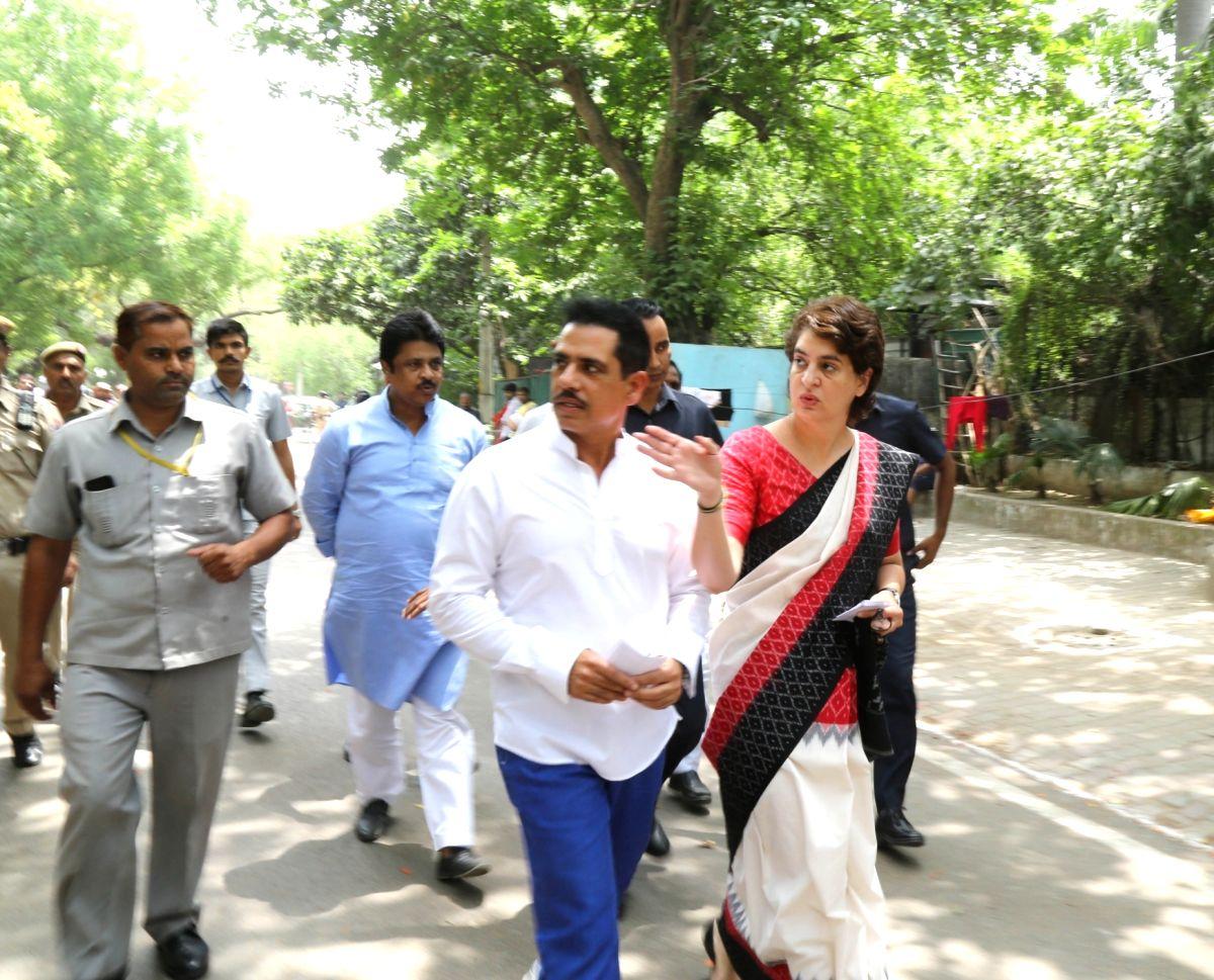 New Delhi: Congress leader Priyanka Gandhi Vadra and her husband Robert Vadra arrive to cast their vote at Sardar Patel Vidyalaya in New Delhi's Lodhi Estate on May 12, 2019. (Photo: Amlan Paliwal/IANS)