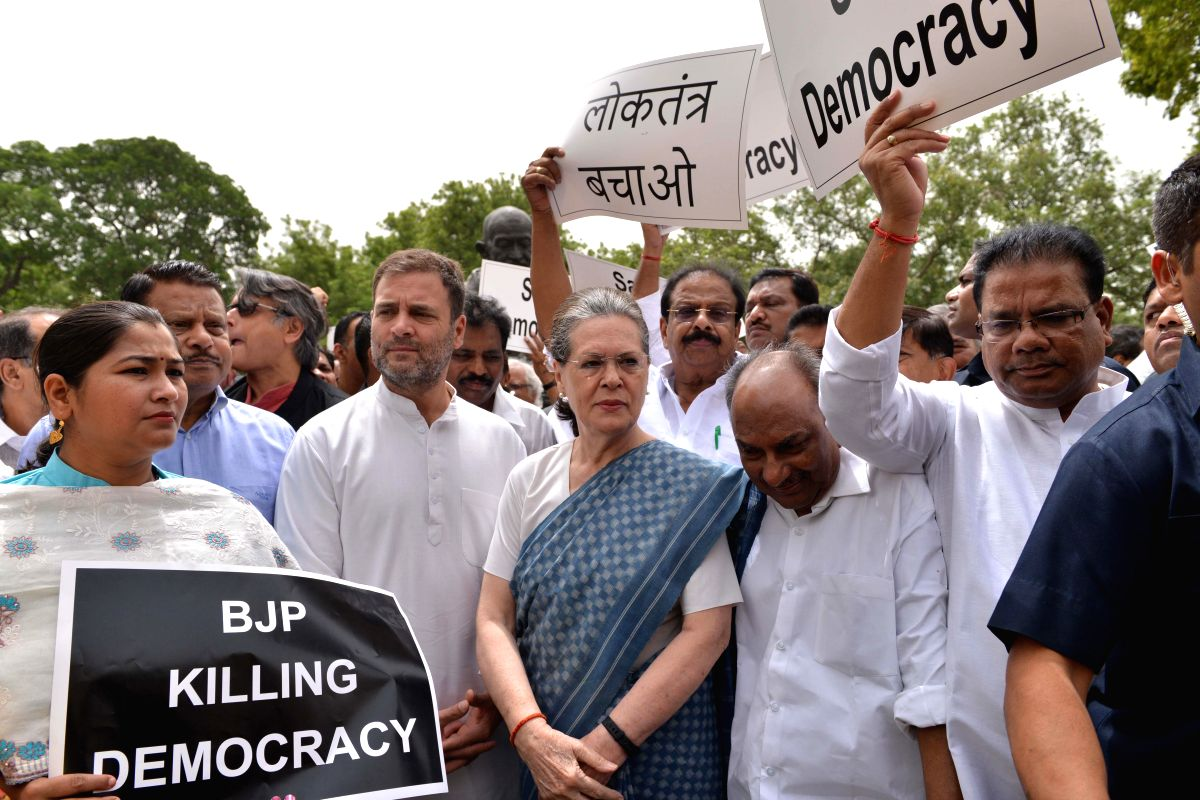 New Delhi: Congress leaders Rahul Gandhi, Sonia Gandhi, A.K. Antony and others stage a demonstration against Karnataka and Goa crisis, outside Parliament House in New Delhi, on July 11, 2019.