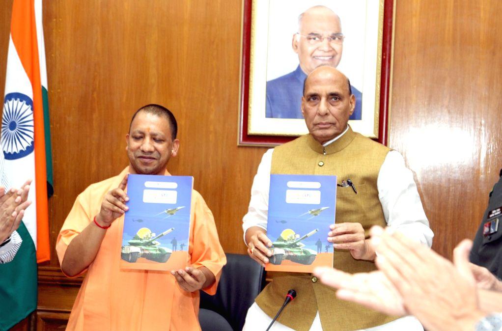 New Delhi: Defence Minister Rajnath Singh and Uttar Pradesh Chief Minister Yogi Adityanath release a brochure on DefExpo 2020, in New Delhi on Sep 9, 2019. (Photo: IANS/PIB)