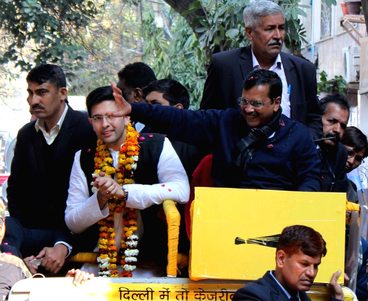 New Delhi: Delhi Chief Minister and Aam Aadmi Party (AAP) National convener Arvind Kejriwal accompanied by the party's Rajender Nagar candidate Raghav Chaddha, holds a roadshow ahead of the Delhi Assembly elections, in New Delhi on Jan 29, 2020. (Pho