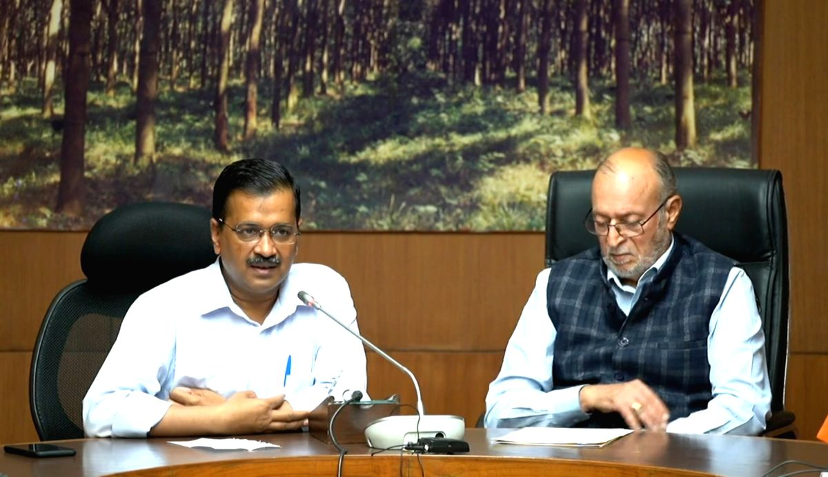 New Delhi: Delhi Chief Minister Arvind Kejriwal accompanied by Lt. Governor Anil Baijal, addresses a digital press conference, where he listed the updates on Delhi's efforts to contain the spread of the COVID-19 virus, on March 25, 2020. Delhi Chief