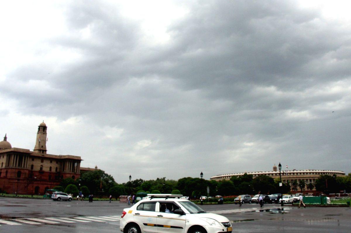 New Delhi: Delhi wakes up to a cloudy day on June 18, 2019. (Photo: Bidesh Manna/IANS)