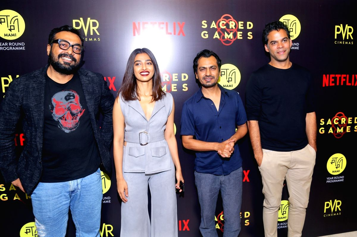"""New Delhi: Director Anurag Kashyap with actors Radhika Apte and Nawazuddin Siddiqui at the special screening of film """"Sacred Games"""" in New Delhi on July 3, 2018."""