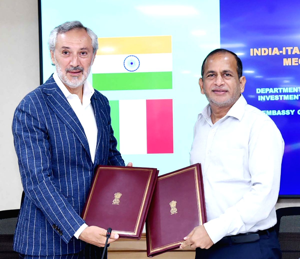 New Delhi: DPIIT Secretary Ramesh Abhishek and Ambassador of Italy to India Lorenzo Angeloni exchangs the documents on setting up fast track mechanism for companies and investors, in New Delhi on July 16, 2019. (Photo: IANS/PIB)