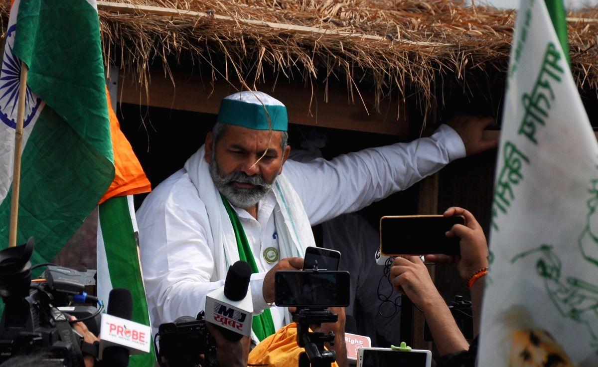 New Delhi: Farmer leader Rakesh Tikait addresses media against farmers' bill during Bharat Bandh by farmers in Ghazipur Border in New Delhi Monday, September 27, 2021. (Photo:Qamar Sibtain/ IANS)