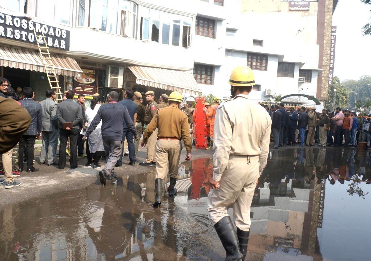 New Delhi: Fire fighters and NDRF personnel outside Hotel Arpit Palace in Karol Bagh where a major fire broke out killing seventeen people, including a child and injuring three others in New Delhi on Feb 12, 2019.