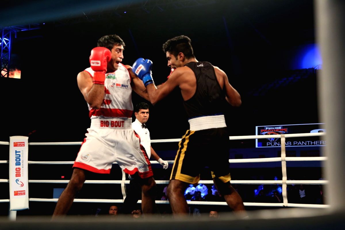New Delhi: Gujarat Giants' Ashish Kumar (L) in action against Punjab Panthers' Mohit during the Big Bout Indian Boxing League at the Indira Gandhi Indoor Stadium Complex in New Delhi on Dec 10, 2019.