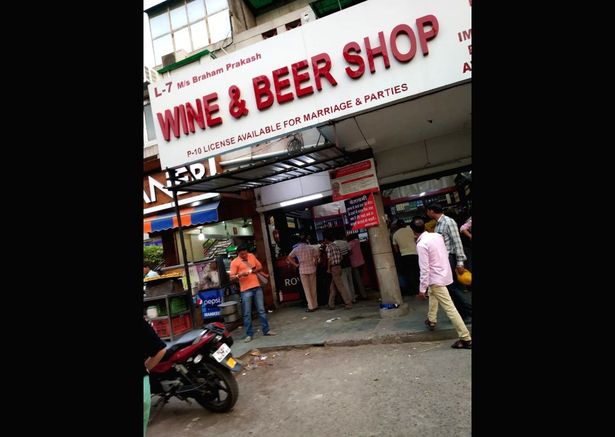 New Delhi: Heavy rush outside a liquor outlet after the polling ended for Delhi's seven Lok Sabha seats.