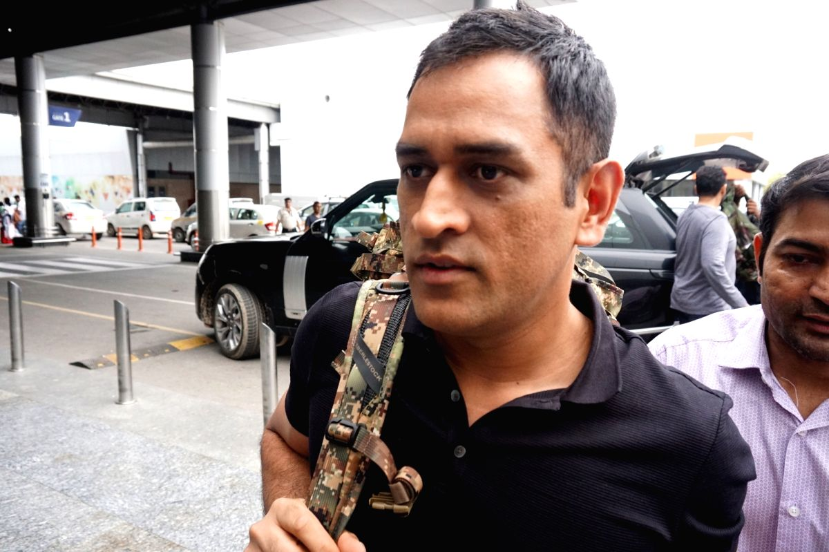 New Delhi: Indian cricketer M.S. Dhoni leaves for Srinagar from Indira Gandhi International Airport in New Delhi, on July 30, 2019. Indian cricketer Mahendra Singh Dhoni, who was awarded the honorary rank of a lieutenant colonel in 2011, will join hi