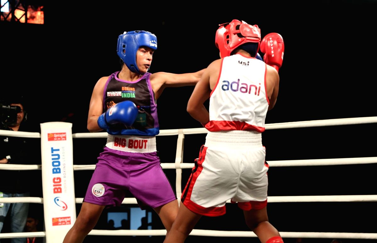 New Delhi: Indian pugilist Nikhat Zareen (in blue) of NE Rhinos in action during Big Bout Indian Boxing League at the Indira Gandhi Indoor Stadium in New Delhi on Dec 7, 2019.