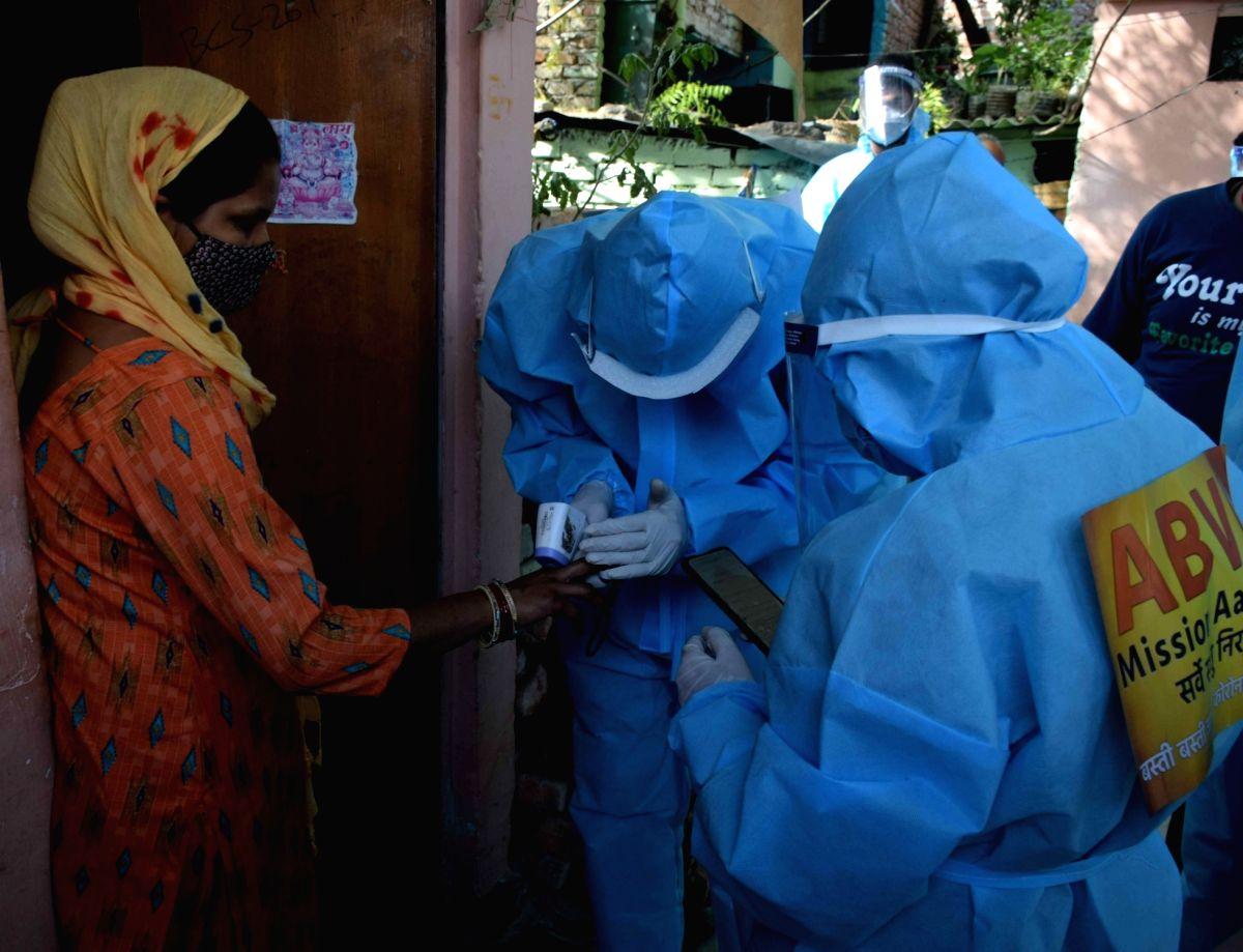 New Delhi: JNU student union  Akhil Bharatiya Vidyarthi Parishad, (ABVP) spotted during  Fever screening test for Covid-19 at Slum area in Vasant vihar but simply  Fever screening test is not an effective way to test for Covid-19  in New Delhi on Sun