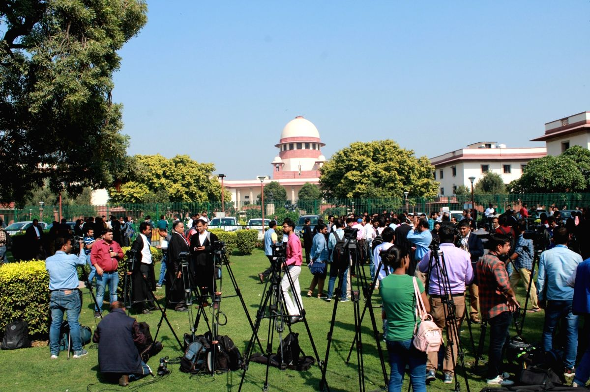 New Delhi: Media persons wait for Ayodhya title dispute verdict outside the Supreme Court in New Delhi on Nov 9, 2019. (Photo: Amlan Paliwal/IANS)