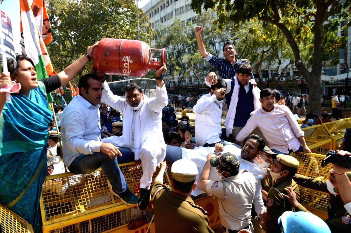 New Delhi: Members of Indian Youth congress holding a protest against price rise of fuel and lpg gas outside Shastri Bhavan in Delhi on Tuesday 02nd March, 2021.