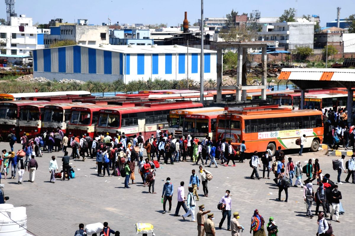 New Delhi: Migrant workers seen leaving for their homes at Delhi's Anand Vihar Bus Terminal on Day 4 of the lockdown imposed in the wake of the coronavirus pandemic, on March 28, 2020.