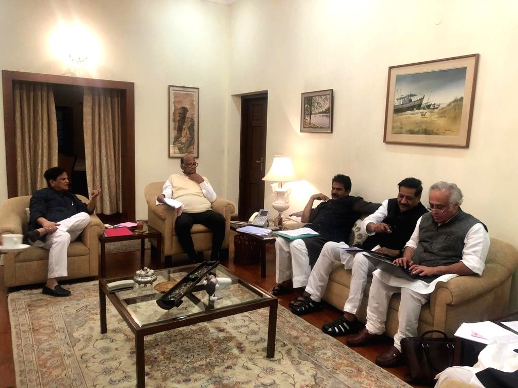 New Delhi: NCP chief Sharad Pawar with Congress leaders Ahmed Patel, KC Venugopal, Prithviraj Chavan and Jairam Ramesh during a meeting of both the parties at NCP chief Sharad Pawar's residence in New Delhi on Nov 20, 2019.