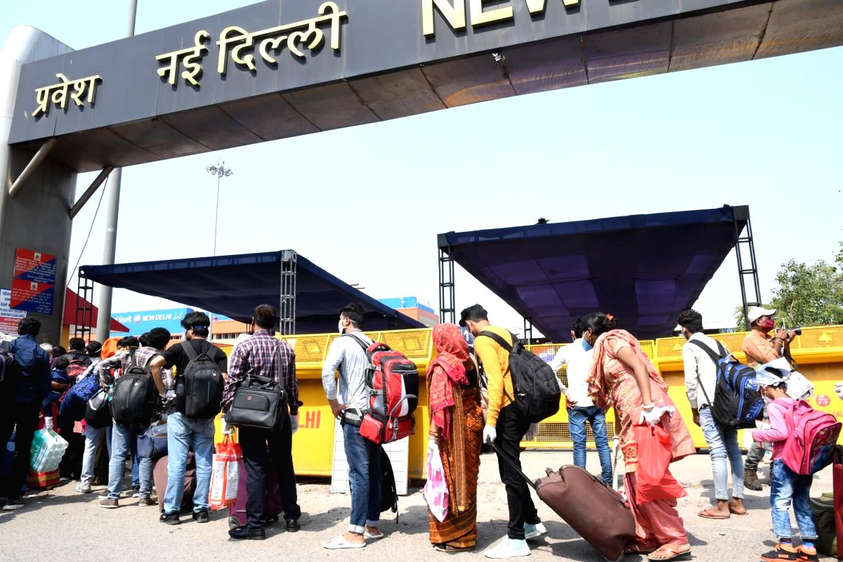 New Delhi: Passengers arrive at the New Delhi Railway Station to board trains to their respective destinations as the Indian Railways is running 200 new time-tabled non-air conditioned trains from today, on the first day of the fifth phase of the nat