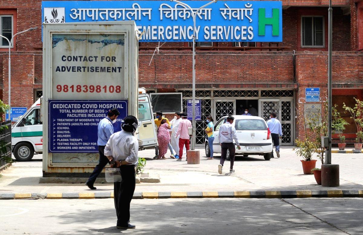 New Delhi: Patient relatives waiting at Lok Nayak Jai Prakash Covid Hospital (LNJP) in New Delhi on Saturday 15 May,2021.(Photo: Wasim Sarvar/IANS)
