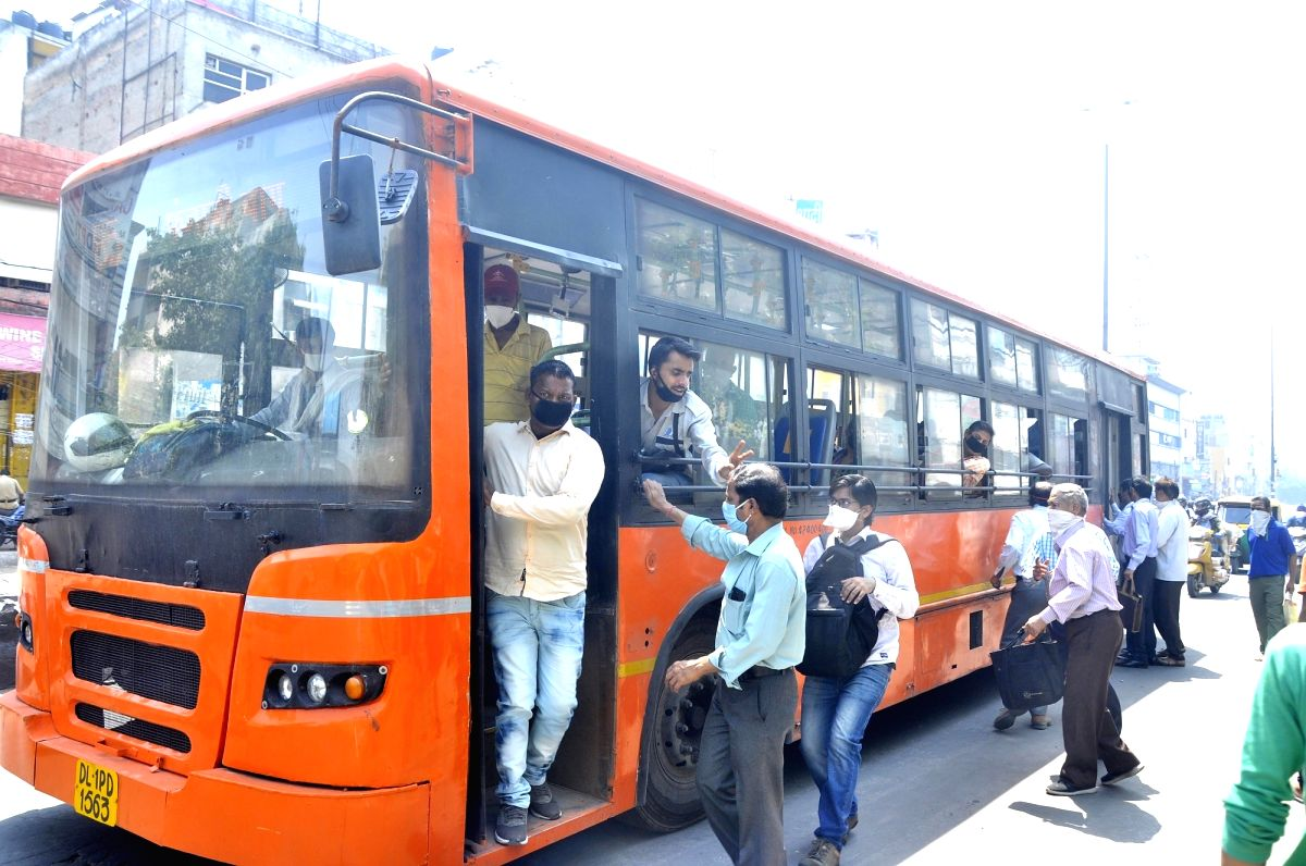 New Delhi: People board Delhi Transit Corporation (DTC) buses on the second day of the fourth phase of the nationwde lockdown imposed to mitigate the spread of coronavirus, on May 19, 2020. Delhi Chief Minister Arvind Kejriwal on Monday extended the