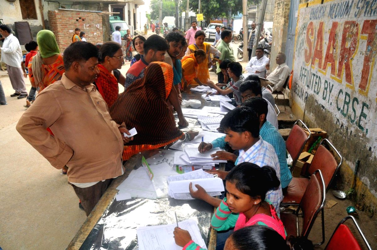 New Delhi: People busy casting their votes for the Bawana assembly constituency bypolls in New Delhi on Aug 23, 2017.