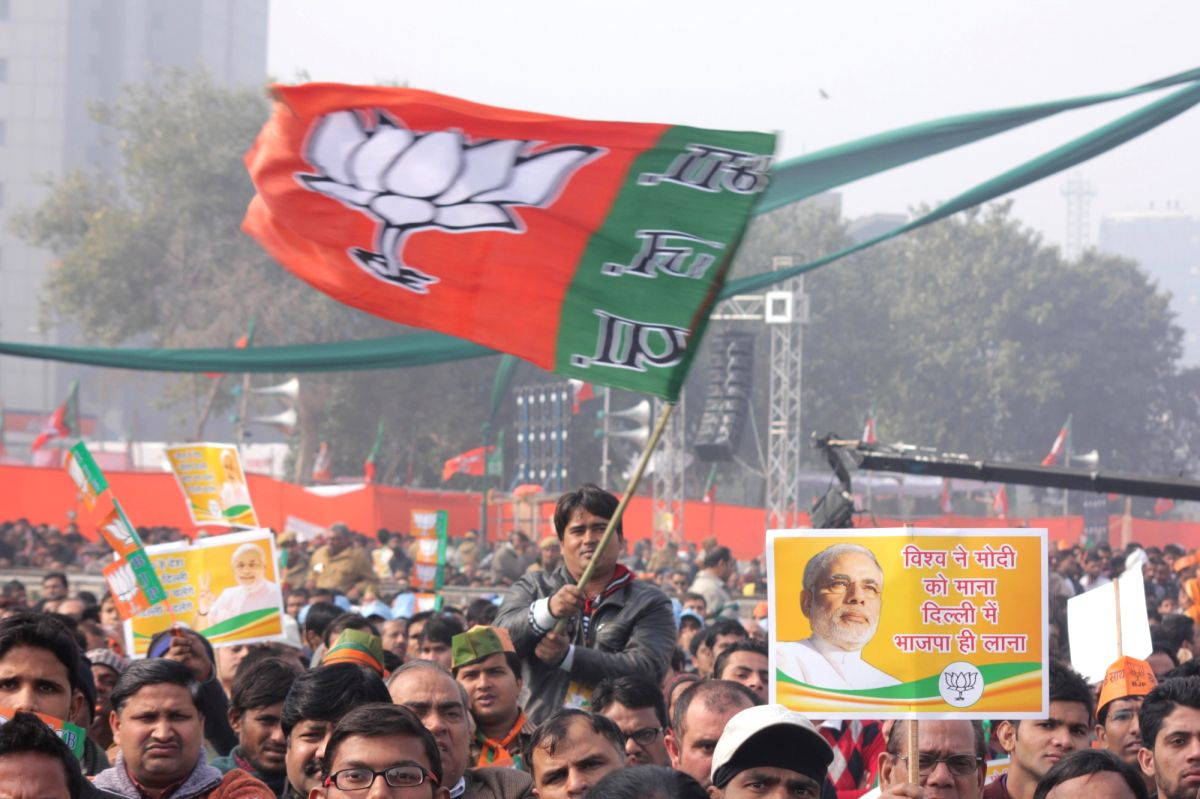 New Delhi: People gather at a BJP rally to celebrate party's success in the recently concluded assembly polls in Jharkhand and Jammu and Kashmir at Ramlila Maidan in New Delhi on Jan 10, 2015. (Photo: Sunil Majumdar/IANS)
