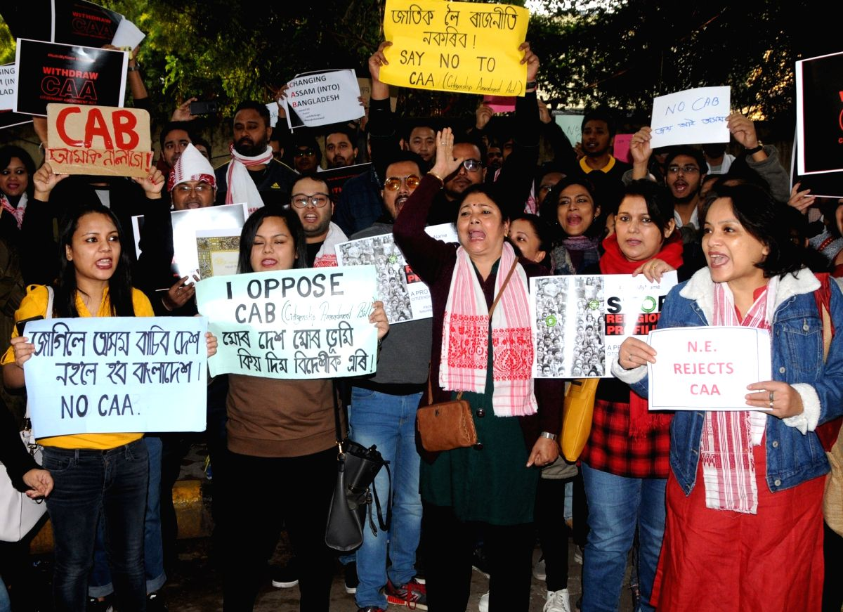 """New Delhi: People of Assam stage a demonstration against the Citizenship Amendment Act (CAA) 2019 during """"#NotInMyName #repealcaa"""" protest rally, in New Delhi on Dec 14, 2019."""