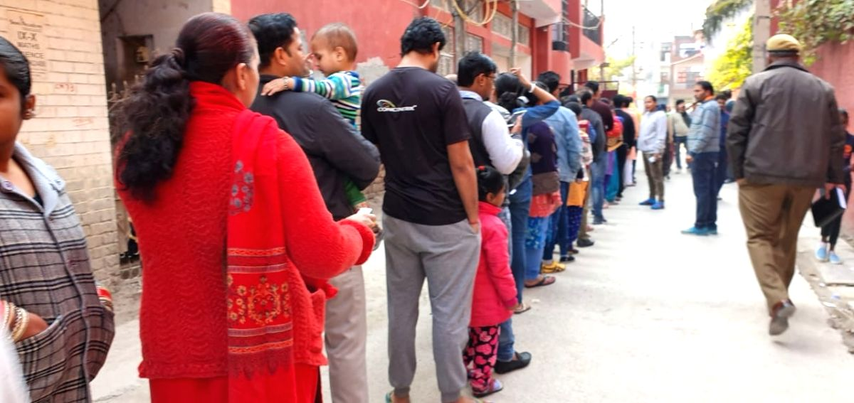 New Delhi: People queue up to cast their votes for the Delhi Assembly elections 2020, at a polling station at Delhi's Dwarka on Feb 8, 2020.