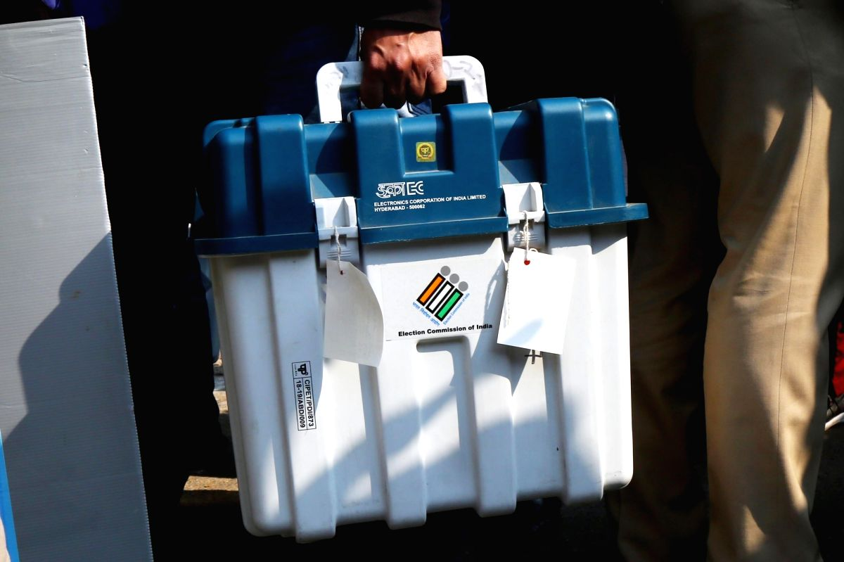 New Delhi: Polling officials checking the Electronic Voting Machine (EVMs) and other necessary inputs required for the Delhi Assembly Election, at a distribution centre in New Delhi on Feb 7, 2020.