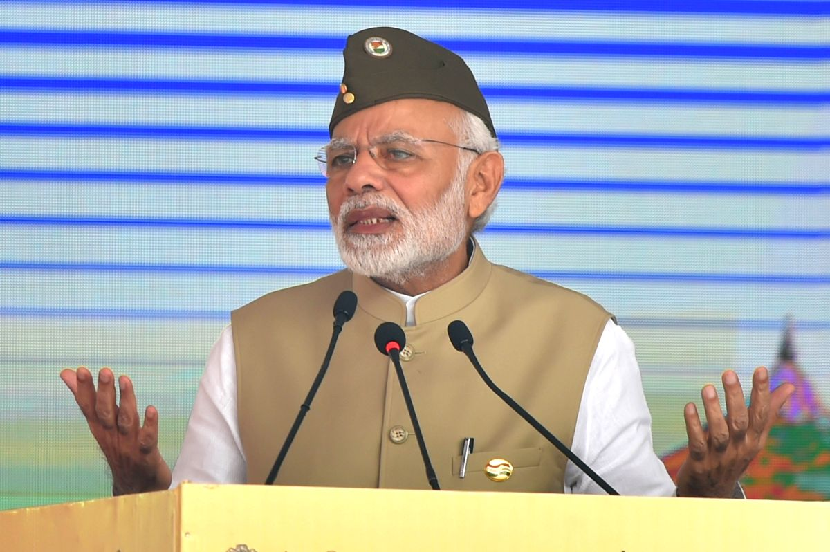 :New Delhi: Prime Minister Narendra Modi addresses during a flag-hoisting ceremony organised to mark the 75th anniversary of the formation of Azad Hind Government, at Red Fort in New Delhi Delhi on ...