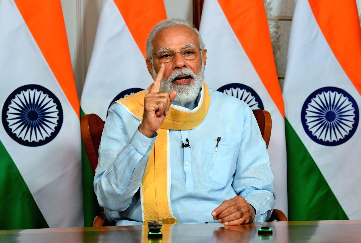 New Delhi: Prime Minister Narendra Modi addresses the 25th Foundation Day of the Rajiv Gandhi University of Health Sciences in Bengaluru via video conferencing, in New Delhi on June 1, 2020. (Photo: IANS/PIB)
