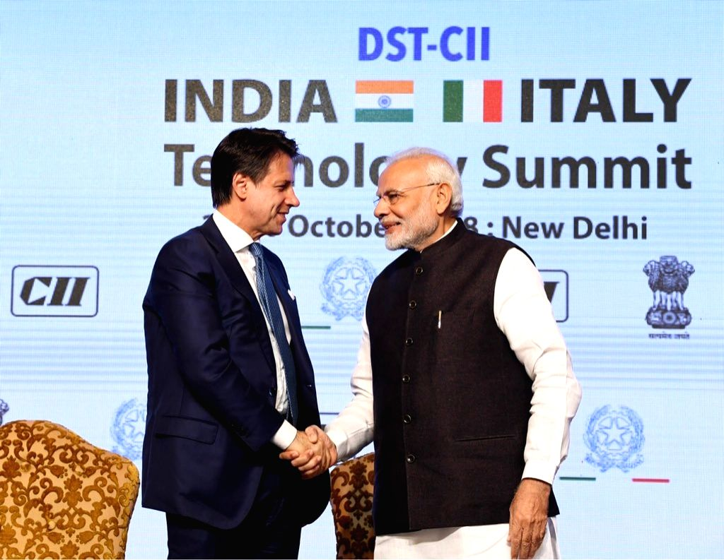 : New Delhi: Prime Minister Narendra Modi and Italian Prime Minister Giuseppe Conte at India-Italy Technology Summit in New Delhi on Oct 30, 2018. (Photo: IANS/MEA).