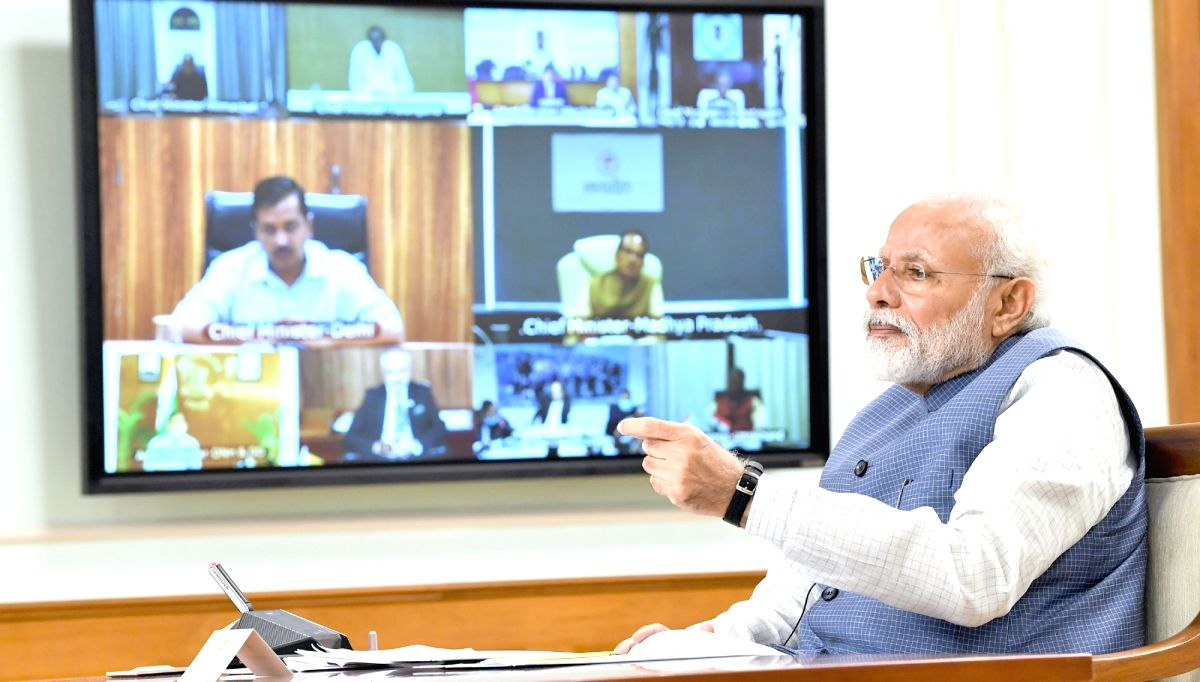 New Delhi: Prime Minister Narendra Modi holds video conference with the Chief Ministers of all the states to discuss measures against COVID-19, on Apr 2, 2020. (Photo: IANS/PIB)