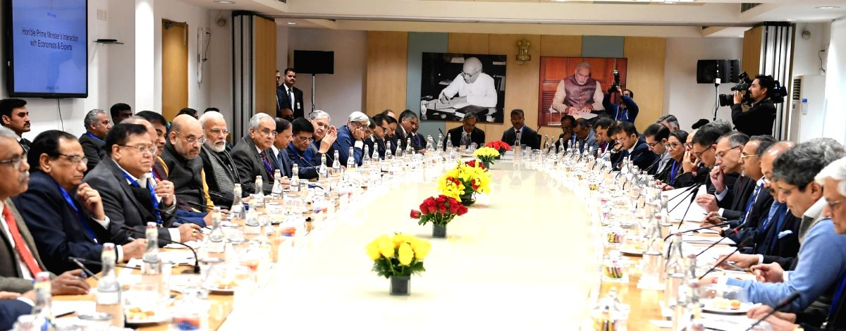 New Delhi: Prime Minister Narendra Modi interacts with the economists and experts in a meeting at the NITI Aayog, in New Delhi on Jan 9, 2020. (Photo: IANS/PIB)