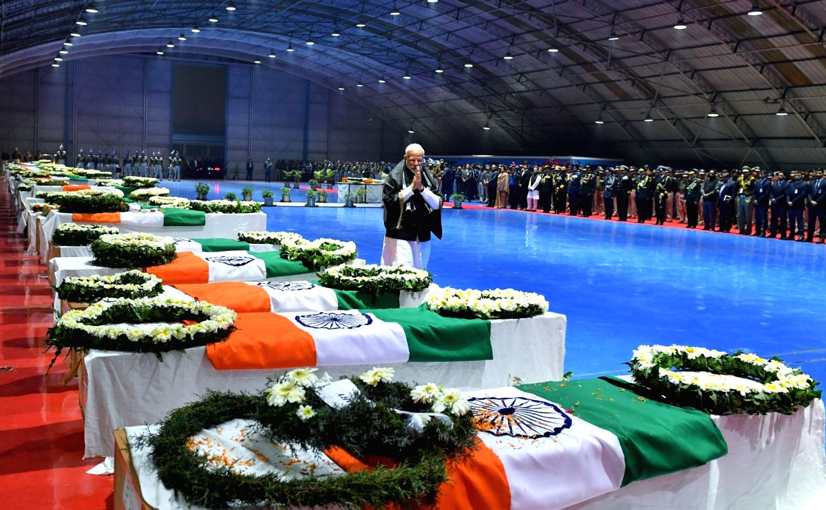 New Delhi: Prime Minister Narendra Modi pays tribute to CRPF personnel who were killed in a suicide attack by militants in Jammu and Kashmir's Pulwama district on 14th Feb 2019; at Palam Airport in New Delhi on Feb 15, 2019. (Photo: IANS/PIB)
