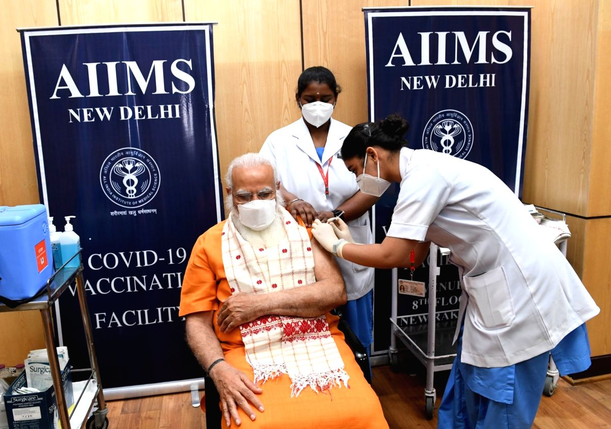 New Delhi: Prime Minister Narendra Modi takes second dose of Covaxin at Delhi's AIIMS On Thursday,08 April, 2021.(photo:IANS)