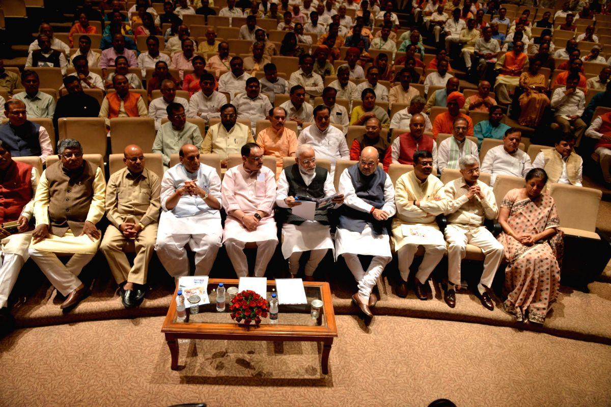 New Delhi: Prime Minister Narendra Modi with Union Ministers Ravi Shankar Prasad, Thawar Chand Gehlot, Rajnath Singh, JP Nadda, Amit Shah, Dharmendra Pradhan, Subrahmanyam Jaishankar and Nirmala Sitharaman during the BJP parliamentary party meeting a