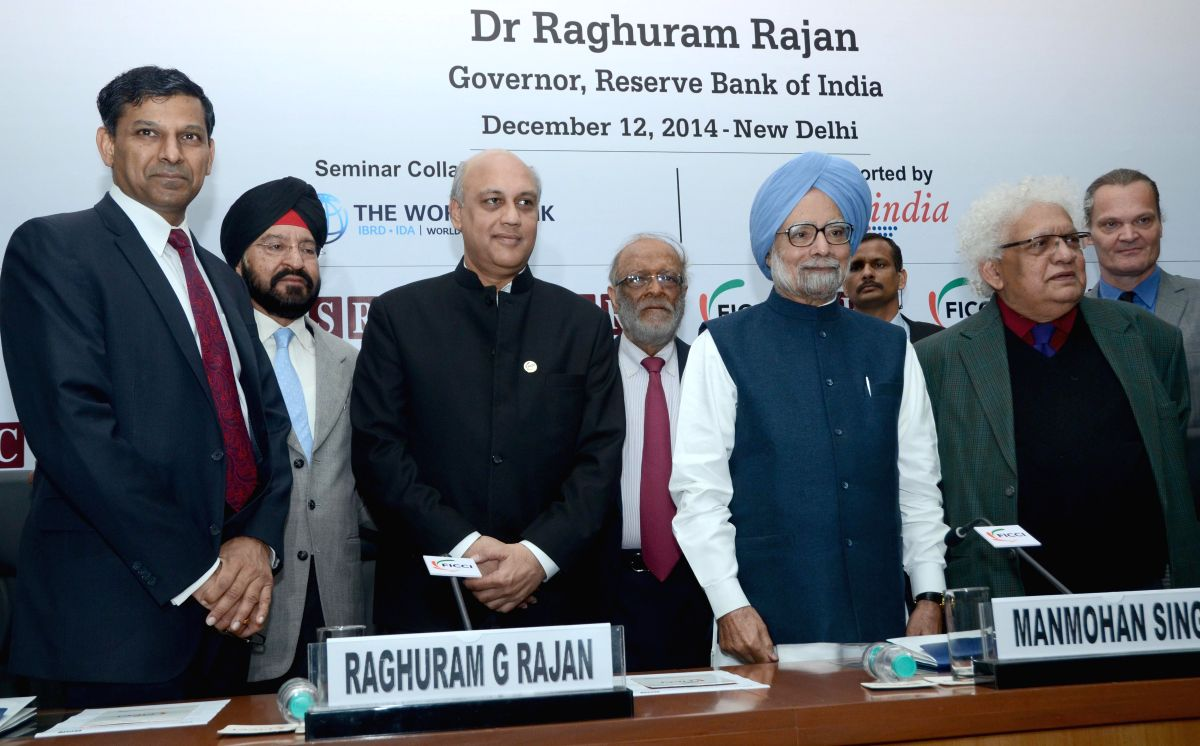 New Delhi: RBI Governor Raghuram Rajan and former Prime Minister Manmohan Singh during `India's Growth Trajectory in a Fractured World Economy: opportunities and Challenges` - a seminar organised by FICCI, in New Delhi on Dec 12,2014. (IAN