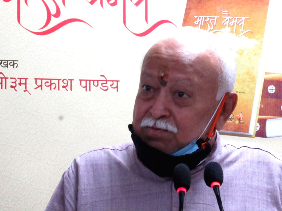 New Delhi : RSS Chief Mohan Bhagwat and Kerala Governor Arif Mohammad Khan during a book release at National Book Trust of India, in New Delhi on Tuesday, August 10, 2021. (Photo: Anupam Gautam/ IANS)