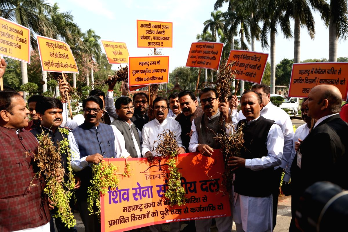 New Delhi: Shiv Sena legislators led by party MP Sanjay Raut, stage a demonstration over various issues, including their demand to declare unseasonal rains in Maharashtra as natural calamity, at Parliament in New Delhi on Nov 18, 2019. (Photo: Amlan
