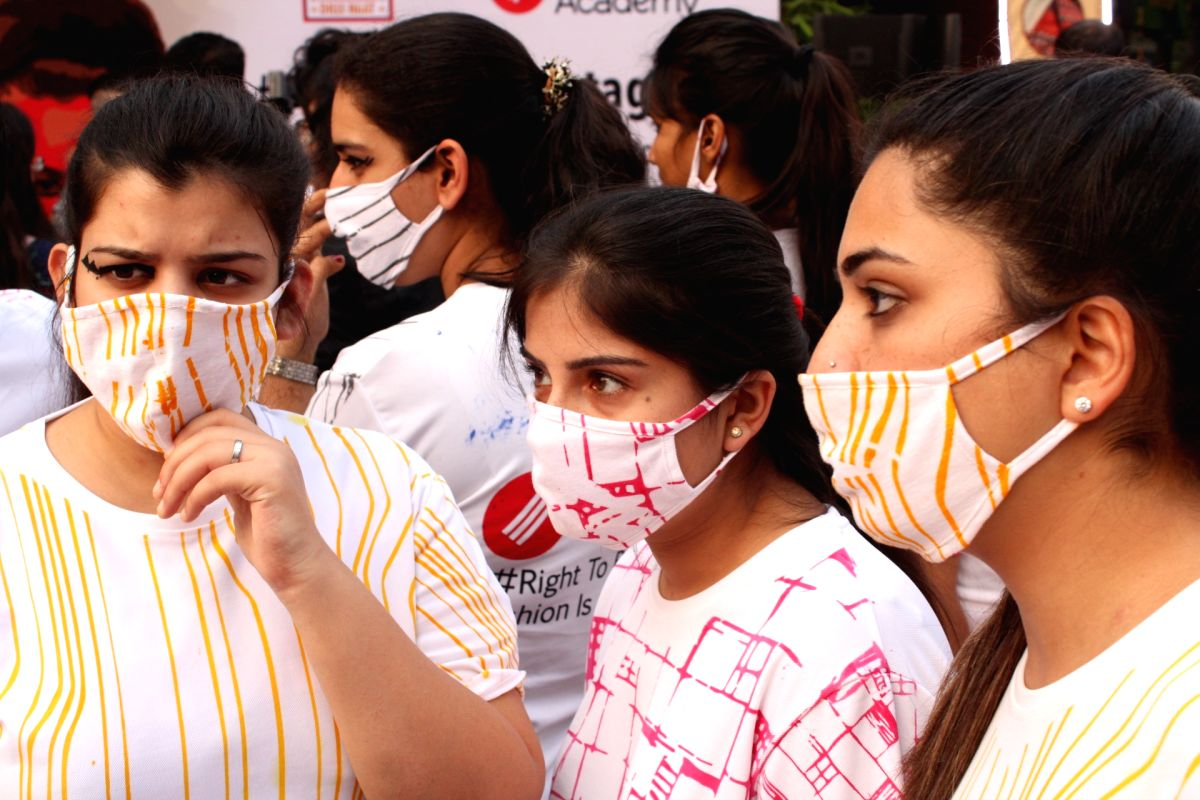 "New Delhi: Students participate in a ""Fashion March"" to spread awareness regarding air pollution and usage of masks at Dilli Haat, INA in New Delhi, on Nov 2, 2018. (Photo: Amlan Paliwal/IANS)"