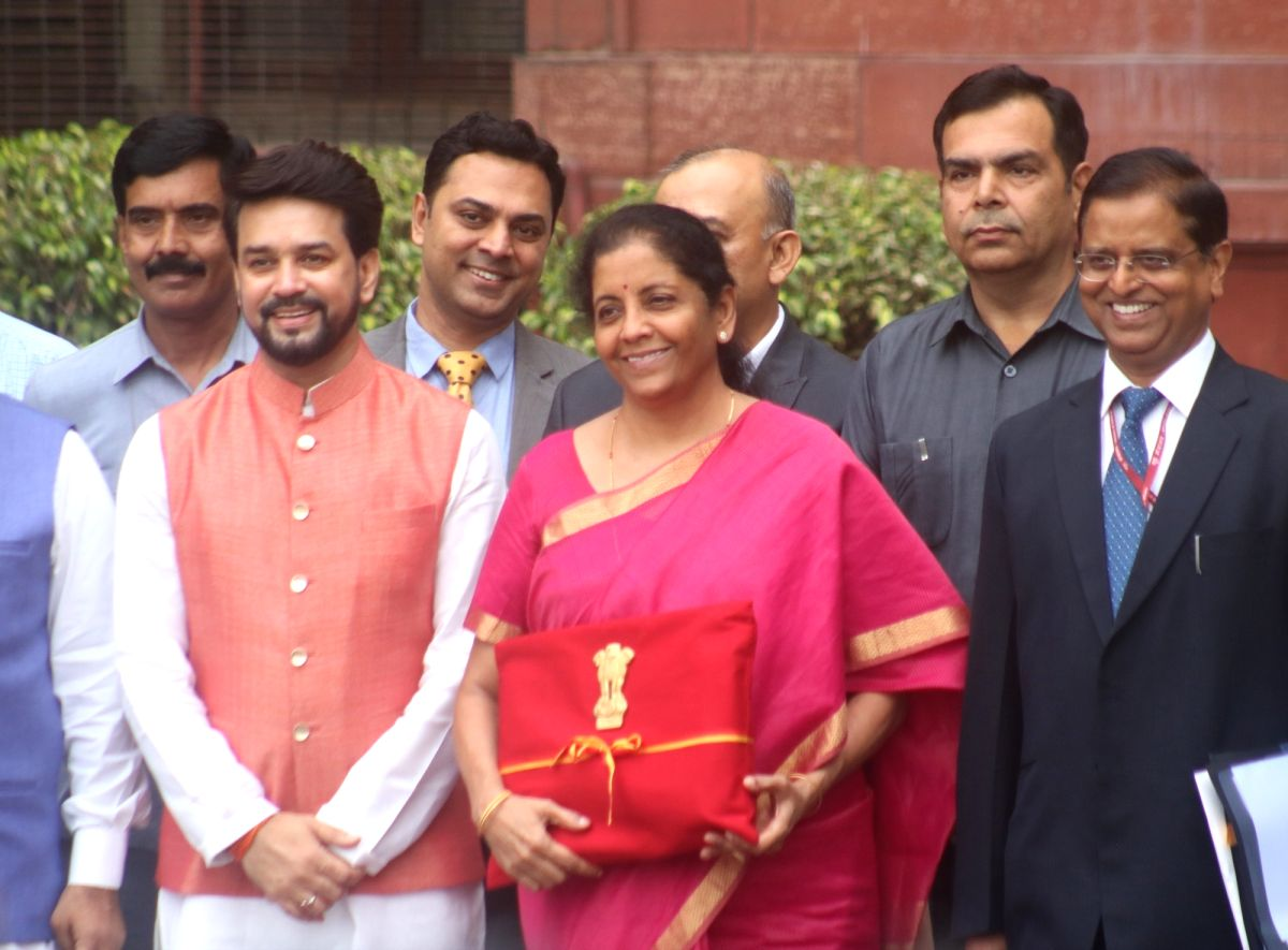 New Delhi: Union Finance Minister Nirmala Sitharaman along with Union Minister of State for Finance Anurag Thakur leaves for Rashtrapati Bhawan from North Block in New Delhi on July 5, 2019. (Photo: Bidesh Manna/IANS)