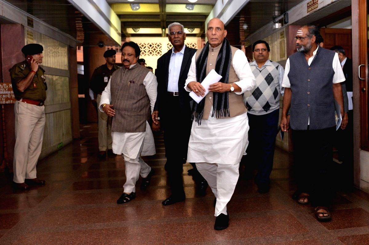 New Delhi: Union Home Minister Rajnath Singh, CPI leader D. Raja and other party leaders depart after the all party meeting on Pulwama terror attack at Parliament House, in New Delhi, on Feb. 16, 2019.