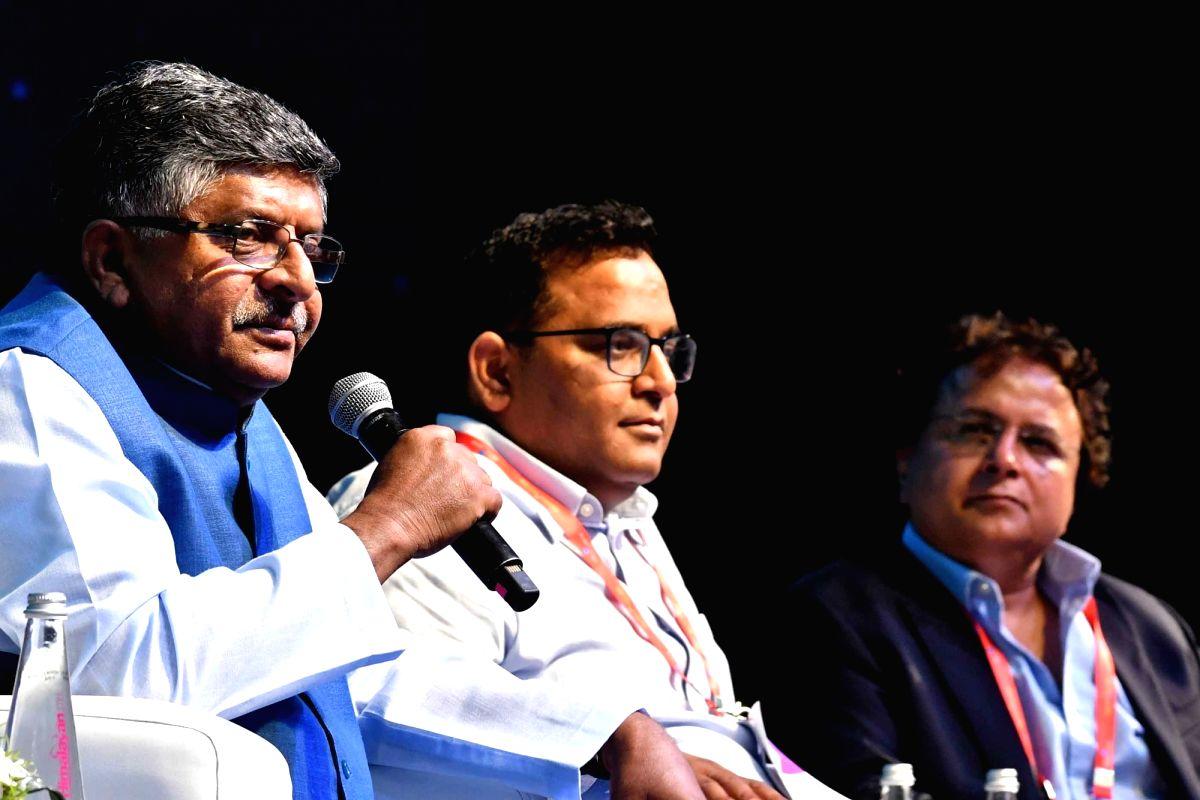 New Delhi: Union Law and Justice, Communications and Electronics and Information Technology Minister Ravi Shankar Prasad accompanied by Paytm Founder Vijay Shekhar Sharma, Lava CMD Hari Om Rai, addresses at India Mobile Congress 2019 in New Delhi on
