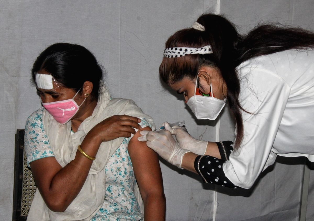 New Delhi: Vaccinator officer inject vaccine for Covid-19 for Teachers and their families at DDU marg in New Delhi on Monday June 14, 2021(Photo: Wasim Sarvar/IANS)