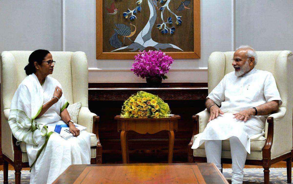 New Delhi: West Bengal Chief Minister Mamata Banerjee meets Prime Minister Narendra Modi in New Delhi on Sep 18, 2019. (Photo: IANS/PIB)