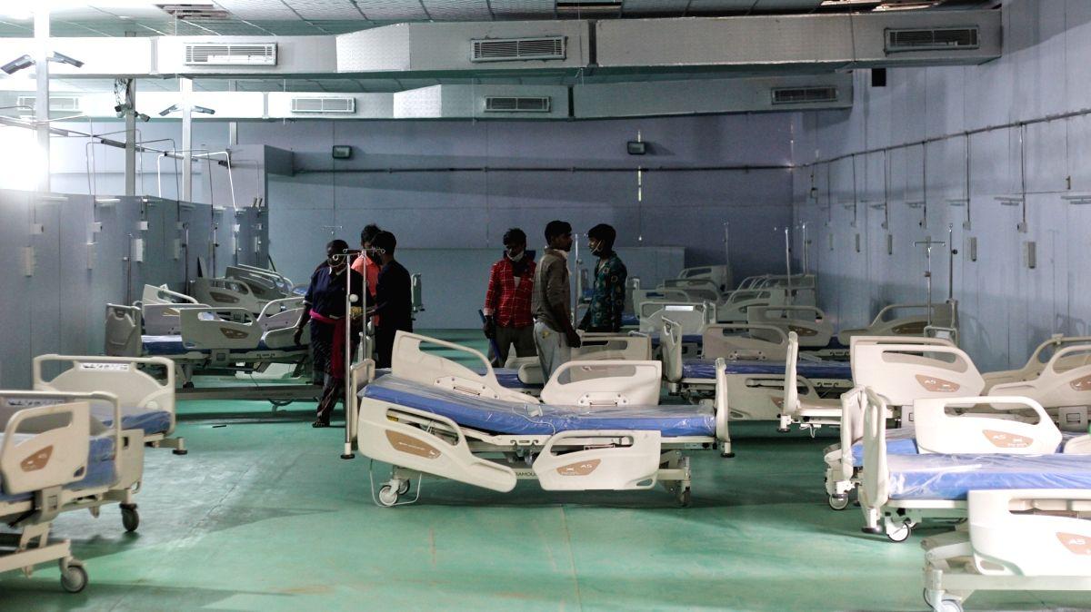 New Delhi : Workers prepared temporary Covid-19 Care Centre by Delhi Government at Ramlila maidan in New Delhi on Tuesday May 11, 2021. (Photo: Wasim Sarvar/ IANS)
