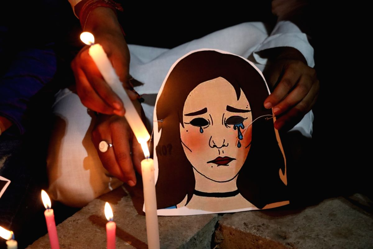 New Delhi: Youth Congress activists participate in a candlelight vigil to protest against the death of Unnao rape victim, highlighting the rise in incidents of crimes against women, in New Delhi on Dec 7, 2019.