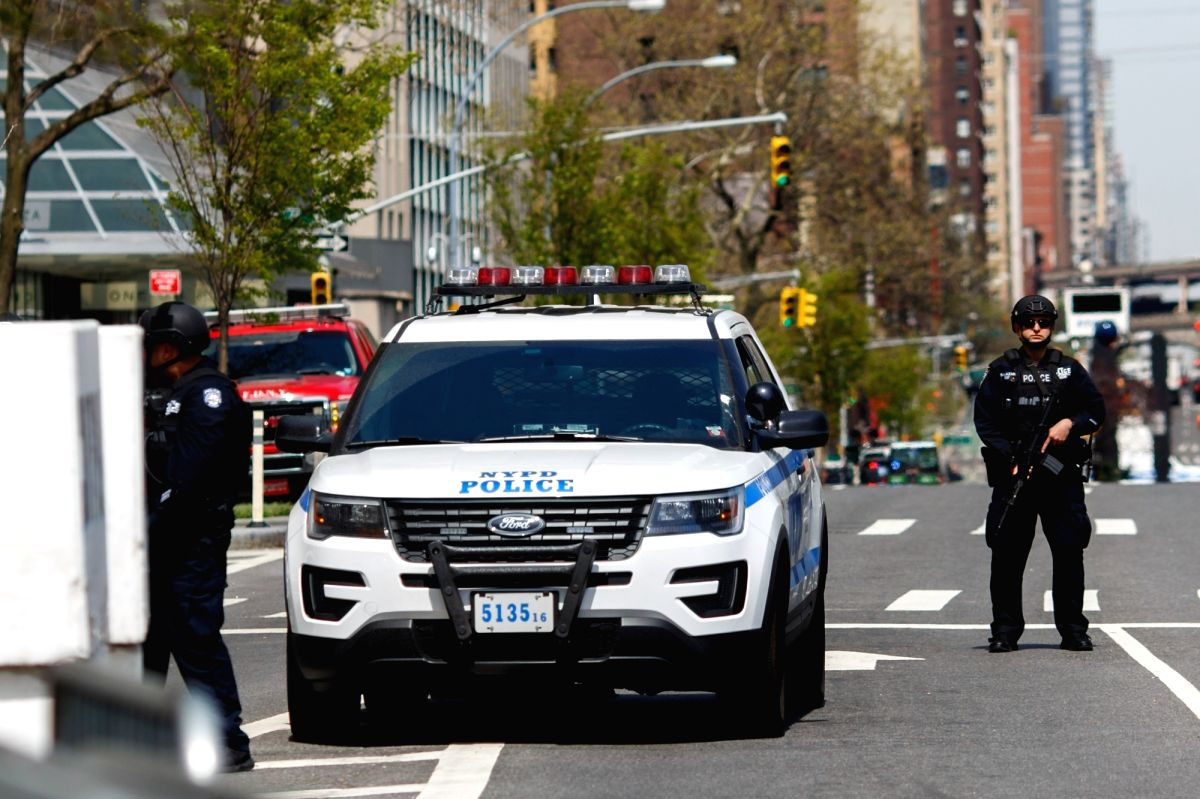 NEW YORK, April 21, 2016 - A NYPD armed police officer stands guard outside the United Nations headquarters in New York, April 21, 2016. More than 165 UN member states are expected to attend a ...